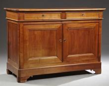 French Louis Philippe Carved Cherry Sideboard, 19th c., the canted corner rectangular top over two frieze drawers above two cupboard...