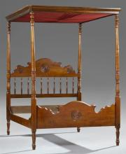 American Late Victorian Carved Walnut Full Tester Double Bed, late 19th c., the canted corner tester on ring turned tapered posts on...