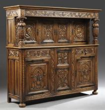 French Jacobean Style Carved Oak Court Cupboard, 19th c., the stepped crown over four cupboard doors, two with portrait medallions,...
