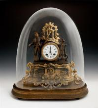 Gilt and Patinated Spelter Figural Mantel Clock. 19th c., time and strike, by Japy Freres, the enamel dial drum clock surmounted by...