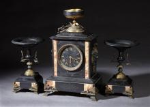 Three Piece French Black and Rouge Marble Clock Set, c. 1880, time and strike, the stepped top with an urn surmount, over a black ma...