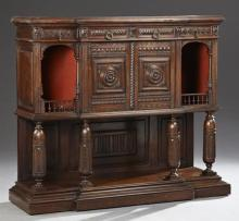 French Renaissance Style Carved Walnut Credenza, 19th c., the stepped breakfront top over two central frieze drawers, above double c...
