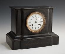 French Black Marble Mantle Clock, c. 1880, by Japy Freres, the movement stamped E. Roth, the shaped case with an enamel dial within...