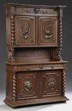 Henri II Style Carved Oak Buffet a Deux Corps, 19th c., the stepped breakfront crown over double cupboard doors with high relief bir...