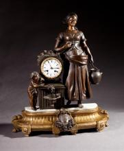 Patinated and Gilt Spelter Figural Mantel Clock, 19th c., time and strike, by Japy Freres, the drum clock atop a fountain with a chi...