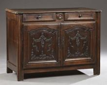 Louis XVI Style Carved Oak Sideboard, 19th c., Provence, the stepped rounded corner top over two frieze drawers above two fielded pa...