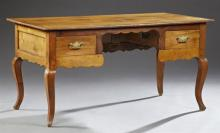 French Provincial Louis XV Style Carved Cherry Desk, 19th c., the rectangular top over a central kneehole flanked by two deep drawer...