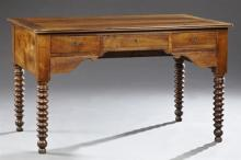 French Provincial Louis Philippe Carved Walnut Desk, 19th c., the rectangular top over a center frieze drawer flanked by deep drawer...