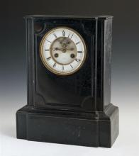 French Black Marble Mantel Clock, c. 1870, by Japy Freres, time and strike, the shaped incised rectangular case with an enamel dial...