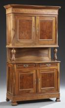 French Louis Philippe Carved Walnut and Elm Buffet a Deux Corps, 19th c., the canted corner stepped crown over double cupboard doors...