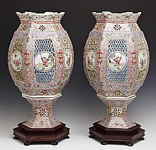 Pair of Chinese Famille Rose Porcelain Lamps, 20th c., the pink ground lamps each composed of a base with pierced decoration and a s...