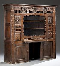 French Provincial Carved Oak Lit Clos, 19th c., Brittany, the stepped crown over spindled sides above cupboard doors, now modified f...