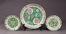Group of Three Chinese Famille Rose Porcelain Pieces, 19th c., consisting of two plates and a large charger, all with floral decorat...