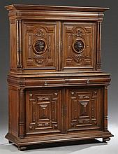 French Henri II Style Carved Walnut Buffet a Deux Corps, 19th c., the stepped crown above two mask decorated cupboard doors within d...