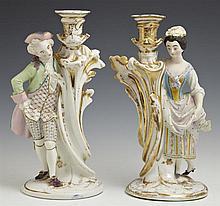 Pair of Franco-Bohemian Porcelain Figural Candlesticks, 19th c., the polychromed biscuit porcelain figures astride gilt decorated fl...