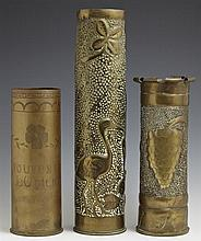 Group of Three Trench Art Brass Vases, c. 1917, including a hand hammered example with relief bird decoration, dated 1917; an engrav...