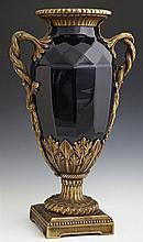 Gilt Bronze Mounted Cobalt Porcelain Handled Vase, of tapered dodecahedron form, with bronze branch form handles, on a bronze socle...