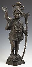 Patinated Bronze Blackamoor Candlestick, 20th c., H.- 15 1/2 in., W.- 6 1/2 in., D.- 5 1/2 in.