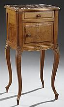 Louis XV Style Carved Walnut Marble Top Nightstand, early 20th c., the highly figured inset rouge marble in a carved stepped edge, o...