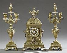 Three Piece Bronze Louis XV Style Clock Set, 19th c., the time and strike clock by H & F, Paris, with a relief urn surmount on a rel...