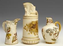 Group of Three Royal Worcester Pitchers, consisting of a mask pitcher, 19th c