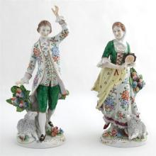 Pair of Continental Porcelain Figures, early 20th c., of a man and woman in 18th c. costume, with lambs at their feet, H.- 8 5/8 in....