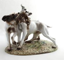 After Guido Cacciapuoti (1853-1927), Porcelain Figural Group of Hunting Dogs, on a relief base, with a paper label, H.- 10 1/2 in.,...