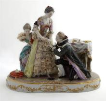 Continental Polychromed Porcelain Figural Group, early 20th c., of a courting couple, in 18th c. costume, the dresses adorned with r...