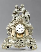 Polychromed Louis XV Style Spelter and Marble Mantel Clock, c. 1850, with a figural surmount of lovers in a garden, over an enamel f...