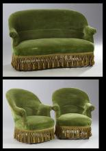 Three Piece French Empire Style Salon Suite, c. 1870, consisting of a settee and two bergeres, with curved backs, scrolled arms and...