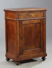 French Provincial Louis XIII Style Carved Oak Confiturier, 19th c., the rectangular top over a frieze drawer above a cupboard door o...