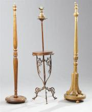Three French Late Victorian Floor Lamps, late 19th c., one example of patinated spelter and beech, a second example of birch with fl...
