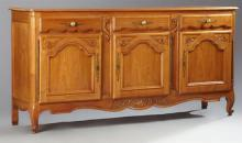 French Louis XV Style Carved Cherry Sideboard, 20th c., the parquetry inlaid rectangular top over three frieze drawers above three c...