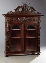 French Henri II Style Carved Oak Buffet a Deux Corps Top, 19th c., the arched crest centered by a high relief stag's head, above two..