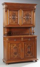 French Henri II Style Carved Walnut Buffet a Deux Corps, 19th c., the stepped crown over double cupboard doors flanked by fluted sti...
