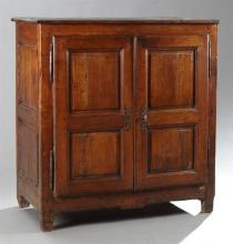 French Provincial Louis XIII Style Carved Cherry Confiturier, mid 19th c., the rectangular top over two double fielded panel cupboar...