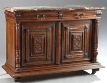 French Henri II Style Carved Walnut Marble Top Sideboard, 19th c., the highly figured rouge marble over two frieze drawers above two...