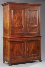 French Louis Philippe Carved Walnut Buffet a Deux Corps, 19th c., the ogee crown over two cupboard doors centered by a stile, on a b...