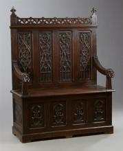 French Gothic Revival Carved Oak Hall Bench, 19th c., the pierced crest over four inset arched carved quatrefoil panels above a benc...