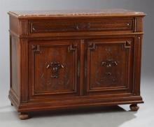 French Henri II Style Carved Walnut Marble Top Sideboard, 19th c., the inset highly figured rouge marble over a frieze drawer above...