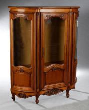French Louis XV Style Carved Cherry Curved Glass Display Cabinet, early 20th c., the demilune breakfront top over a central door wit...