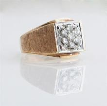 Lady's 14K Yellow Gold Dinner Ring, the square top mounted with a ten point center round diamond bordered by six 7 point round diamo..