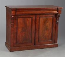 Diminutive English William IV Carved Mahogany Sideboard, 19th c., the breakfront top over a cavetto carved frieze drawer above two c...