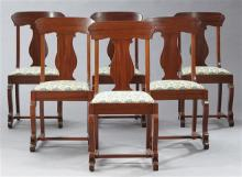 Set of Six American Classical Style Carved Mahogany Dining Chairs, c. 1900, the curved tablet crest rails over vasiform splats above...