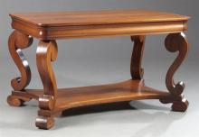 American Classical Revival Mahogany Library Table, c. 1900, the cyma-molded frieze with a single drawer, raised on scroll legs on a...