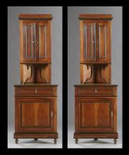 Pair of French Empire Style Carved Walnut Corner Cabinets, c. 1870, the stepped crowns over two cupboard doors above an open shelf o...