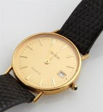 Man's Geneve 18K Yellow Gold Quartz Wristwatch, with a sapphire mounted winding knob. Provenance: Peacock's Estate Jewelry, Royal St.