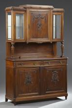 Carved Walnut Louis XVI Style Buffet a Deux Corps, early 20th c., the stepped top with a relief floral carved door flanked by glazed...