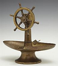 Unusual Continental Brass Hand Hammered Cigar Cutter Ashtray, c. 1900, in the form of a ship's wheel, H.- 7 1/2 in., W.- 7 3/8 in.,...
