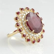 Lady's 14K Yellow Gold Dinner Ring, with a 14.88 carat oval ruby atop a diamond mounted border within a pierced outer border of roun..